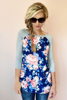 FLORAL PRINT BASEBALL SLEEVE TOP, 3/4 SLEEVES-BLUE Body 95% Rayon 5% Spandex, Floral front 100% RayonMeasures approximately 29 inches in lengthHand wash, cold w