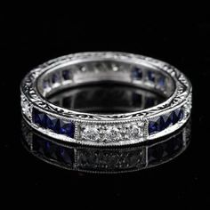 This gorgeous ,art deco design, platinum eternity band contains 12 French cut natural blue sapphires (Princess cut - approx. 1cttw) channel set and 12 round brilliant diamonds pave set (G-H color and