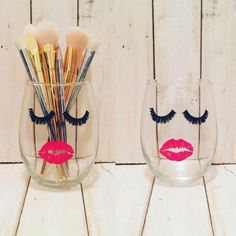 Love wine? Love makeup? Well then you need these brush holders from Etsy. Made from wine tumblers and painted with bold lashes and kisses, they just beg to be part of your vanity station.