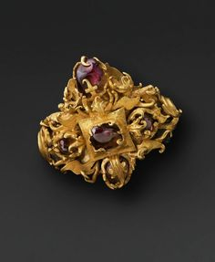 Ear Ornament  --  7th-10th Centuries  --  Java, Indonesia  --   Gold & ruby  --  The Yale University Art Gallery
