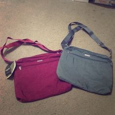 Brand new baggallini large zipper bagg! $50 for both or $30 each. Bags Crossbody Bags