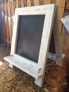 Chalkboard easel - for writing the sentiment on. The legs would anchor in the sand to keep it from blowing over.