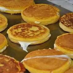 "Corn Pancake Sandwiches ""Arepas de Choclo"" on BigOven: The traditional arepa served in Miami has two cornmeal pancakes with a layer of cheese inside. Anything to do with cornmeal pancakes, I'm in. Corn Pancakes, Cornmeal Pancakes, Good Food, Yummy Food, Tasty, Colombian Food, Colombian Arepas, Colombian Recipes, Colombian Cities"