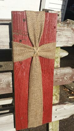 Barn siding with burlap and twine cross wall plaque. Reclaimed rustic wood sign.