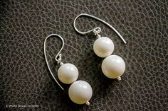 Ivory Swarovski Crystal Pearls Earrings by designbybehin on Etsy. https://www.etsy.com/listing/151116645/ivory-swarovski-crystal-pearls-earrings?ref=shop_home_active_1