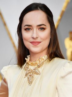 The Best, Brightest, and Most Jaw-Dropping Jewelry at the 2017 Oscars - Dakota Johnson in Cartier from InStyle.com