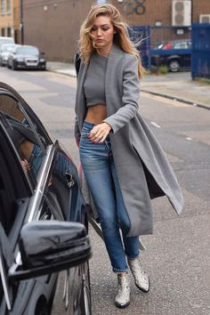 Gigi Hadid wearing Lavish Alice Grey Marl Royal Tie Coat, Lavish Alice Grey Marl Press Stud Detail Racer Crop Top, Zadig & Voltaire Mods Boots in Python and Re/Done High Rise Crop Jeans