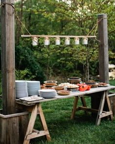 Rustic chic wedding dessert table - love the lighting detail with a row of hanging jars #wedding #diywedding #rusticchic #desserttable #weddingdessert