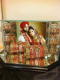i would love to put my wedding jewelry and photo in a display like this :') Wedding Chura, Bridal Chura, Sikh Wedding, Punjabi Wedding, Wedding Pics, Wedding Jewelry, Wedding Ideas, Wedding Goals, Bridal Jewellery