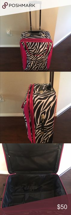 J garden suitcase Pink & zebra print large suitcase with wheels & kick stand. Fair condition. Used as I was younger but no longer use it anymore. If you have any questions or want additional pictures please don't hesitate to ask! Make me an offset & I'm willing to negotiate :) J Garden  Bags Travel Bags