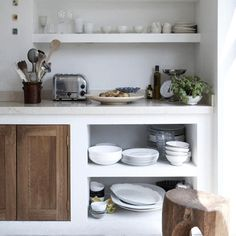 open shelves and the contrast of white and wood