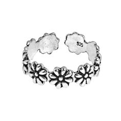 Embellish your toes with this sweet flower ring. Fashioned of sterling silver, this toe ring or pinky ring will add charm to your style. Product Features: Condition: New Metal: Sterling silver Style: