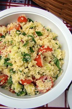 This picnic perfect Couscous Salad recipe is full of summer flavor with cherry tomatoes, fresh parsley and mint. It's perfect for packing up and taking on a picnic.