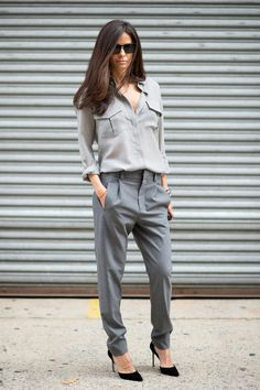 The military touches on this top and the no-nonsense glasses balance out the deeper neckline, and we always love a slouchy trouser with heels.