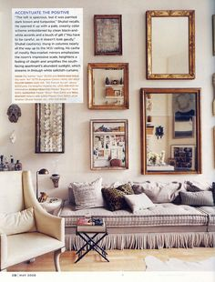 I adore the wall display of vintage mirrors!