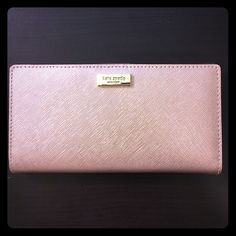 Brand new Kate spade Stacy wallet Brand new with tag in rose gold and 100% authentic!! kate spade Bags Wallets