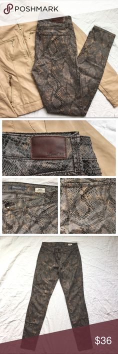 Level 99 Snake print skinnies Level 99 Snake print Ultra skinny jeans | Bundle with Moto Jacket for extra discount on jacket, just ask!  Super flattering fit and the print is Beyond Rad! Black Snake skin pattern with a slight metallic bronze/copper sheen against classic grey. Soft, stretchy and flattering 😏 Faux front pockets  Inseam: 29 inches Rise Front: 7.5 inches  Rise Back: 11 inches Leg opening: 5 inches  Hips/waist: 13.5 inches laying flat 42% Lyocell (softness) 33% cotton 15% Rayon…
