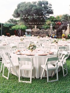 """Guest tables with White Resin Chairs (66"""" round tables with Ivory linens and Peach napkins)"""