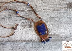 Hand forged, lapis lazuli and copper on leather cord