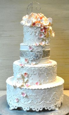 Vintage lace wedding cake with silver belt and gumpaste flowers by www.thecakezone.com