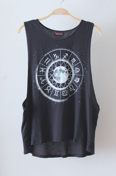 Rad muscle tank with deep armholes and longer back length.  Tank features Zodiac chart graphic on front.  Slightly loose fit.  Looks amazing with black denim and moto boots!  Available in WHITE & BLACK    Photo shown: Small  Bust (left to right front of shirt): 12.5 inches  Front length: 23.5 inc...
