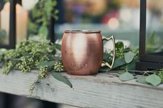 Commemorative copper mugs are a fun wedding party favor to give for a rustic wedding. Photo via Project Wedding