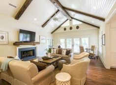 White vaulted ceiling with wooden beams in the living room of 301 Surfsong Road on #Kiawah Island (available for sale as of 05.10.16) #LuxuryRealEstate