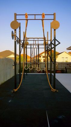 Outdoor home gym rogue fitness crossfit bars ropes wall ball obsessed