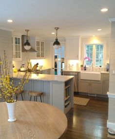 Kitchen with white uppers and blue gray lower cabinets