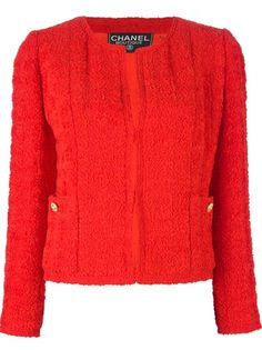 CHANEL VINTAGE Bouclé Jacket from A.N.G.E.L.O. VINTAGE PALACE. Red wool bouclé jacket from Chanel featuring a round neck, a concealed front fastening, long sleeves with gold-tone buttoned cuffs, patch pockets at the sides and a straight hem.