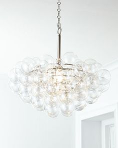 """Ocean-inspired pendant light. Glass bubbles on a metal frame. Uses one 100-watt bulb. Direct wire; assembly and professional installation required. 27.5""""Dia. x 23""""T with 6'L chain. Imported. Weight, 2"""