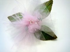 Tulle is a neat ribbon to work with it. It is very lightweight, looks great stacked, and bends easily. I like working with tulle especially when it comes to making flowers.