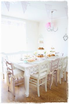 Used standard table. Strung chandelier. 3 tiered stand for snacks.