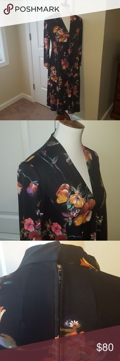 """Vintage 1970s Floral Maxi Long sleeved floral maxi dress Vintage and beautiful  Great v neck line Beautiful floral print  Measurements  Lengthy 43"""" Bust 34"""" Sleeve 29"""" Waist 38""""  Materials: No tag available  Jersey material and Rayon  In perfect condition Vintage Dresses Long Sleeve"""