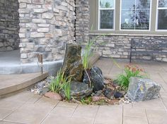 a spouting rock certainly adds interest to any landscape without the work of a pond, outdoor living, ponds water features, A pouting rock at this homeowner s front door adds interest and the sound of water Small Backyard Landscaping, Landscaping With Rocks, Small Patio, Landscaping Ideas, Easy A, Small Water Features, Backyard Water Feature, Diy Porch, Small Places