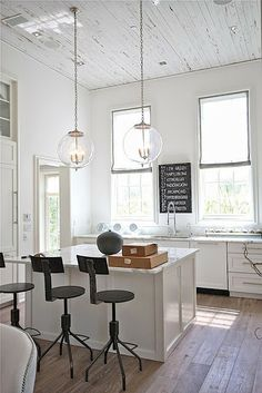 COCOCOZY: WOOD CEILINGS - PAINTED OR UNPAINTED - white kitchen beach house rosemary beach. Love the metal bar stools!