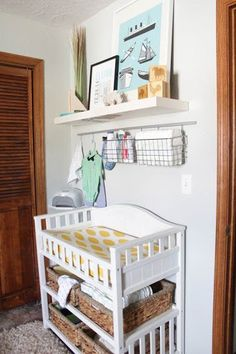 the rack above the changing table for storage. And then a shelf to soften it up. Im guessing I can find this at IKEA??