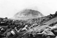 U.S. Marines stay low to avoid the murderous, incoming Japanese fire as they crowd the black-sand beaches of Iwo Jima on February 19, 1945. Over 30,000 men from the 3rd, 4th and 5th Marine Divisions landed during the initial waves. Sadly many of those brave warriors would never leave the beach on that first day. www.devildoggraphix.com