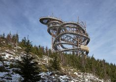 Fránek Architects' Sky Walk loops around a giant slide