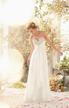 Mori Lee Voyage 6773 is a beautiful A-line dress. This delicate chiffon dress features sparkling crystal beading on the bodice. This gown also features an open back and a small train. This gown is unique with its breakaway skirt.