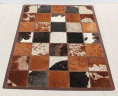 Nguni Skin Block Rug Carpet Condition:  Used  Nguni Skin Block Rug Carpet  size: 1590 L x 1030 W  R3500  Cell 076 706 4700  Tel 021 - 558 7546  www.furnicape.co.za  0314