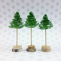 """""""Tiny trees, all made the same, yet unlike the other.  #concordand9th #papercrafting #takeabough #christmastrees #tistheseason"""""""