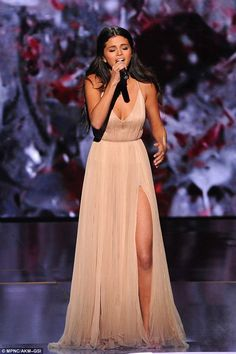 Emotional: Selena donned a thigh-baring, nude Giorgio Armani gown to perform her new single The Heart Wants What It Wants, which was written about her on/off boyfriend Justin Bieber