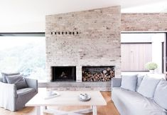 Image 13 of 18 from gallery of Cedar Lane House / Edward Birch. Photograph by Edward Birch Brick Fireplace Wall, Painted Brick Fireplaces, Brick Interior, Interior Walls, Interior Design, Living Area, Living Spaces, Living Rooms, Recycled Brick