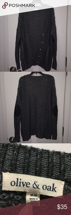Urban Outfitters Chunky Oversized Cardigan UO Olive & Oak dark gray chunky oversized cardigan with patches on the elbows. Size M. Oversized fit so could fit a S/M/L depending on the fit you want. Gently worn but no visible pulling/pilling. Urban Outfitters Sweaters Cardigans