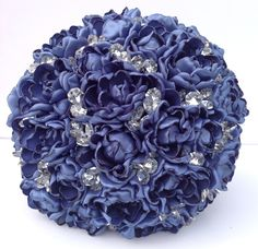 A personal favorite from my Etsy shop https://www.etsy.com/listing/264735829/hand-sculpted-smoke-blue-satin-peony