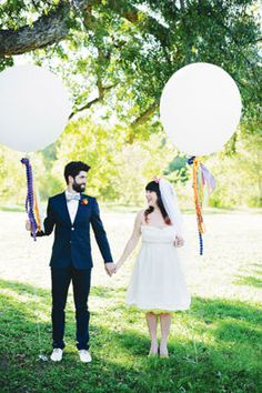 Michaels.com Wedding Department: Whimsy Carnival Wedding Giant Balloons These giant balloons make an excellent addition to your wedding day decor when they are embellished with coordinating colors!