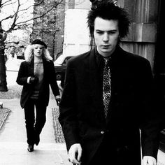 Sid and Nancy<3 although I feel like in this picture Nancy hurt his feelings so he is walking ahead of her so she doesn't see him hurt.. But then again I am a hopeless romantic.