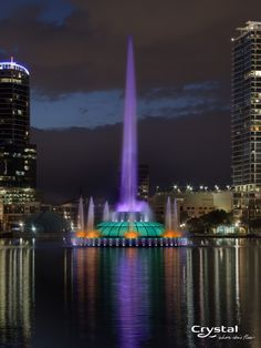 Lake Eola Park in Orlando, FL At night the fountain slowly changes to every color in the rainbow.