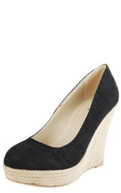 Ever since Kate Middleton stepped out in her L.K. Bennett shoes, I was hooked on black closed toe wedges!  Looks cute with almost anything!